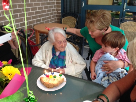 Discussing who will have the biggest piece of 99th birthday cake, with one of her 6 great grandchildren