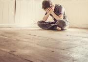 stock-photo-sad-boy-alone-in-a-bare-room-189053942