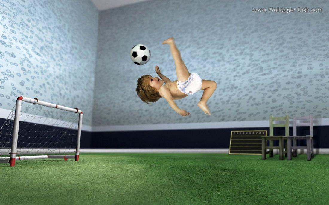 Baby playing football